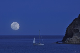 Sailing boat at midnight